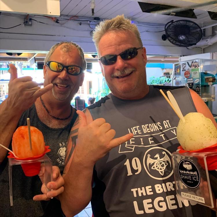 life begins at 50 tshirt guy throwing shaka at breakwall shave ice happy hour maui