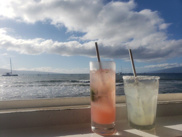 Cocktails by the Ocean Looking at Sailboats during Happy Hour on Maui