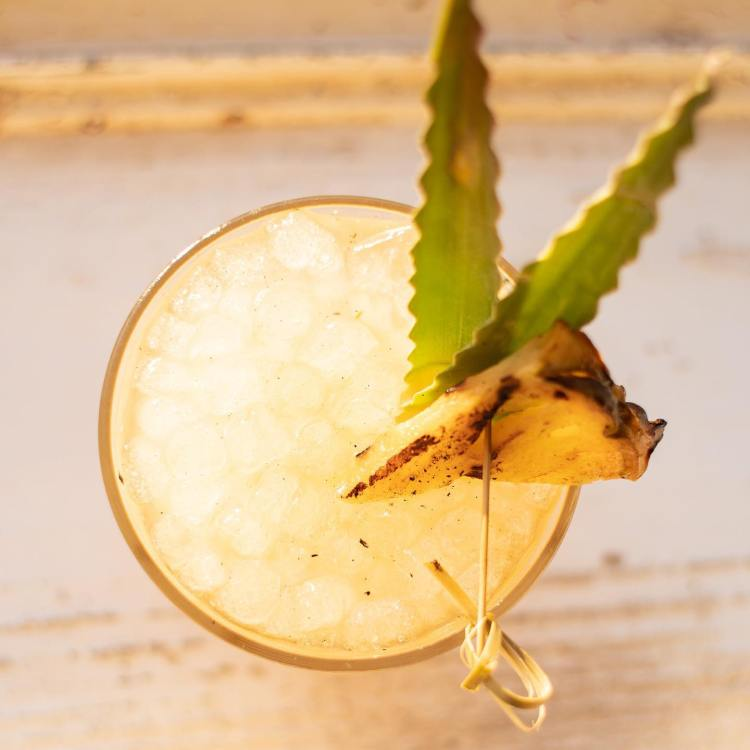 Happy Hour Tropical Cocktail with Pineapple Garnish