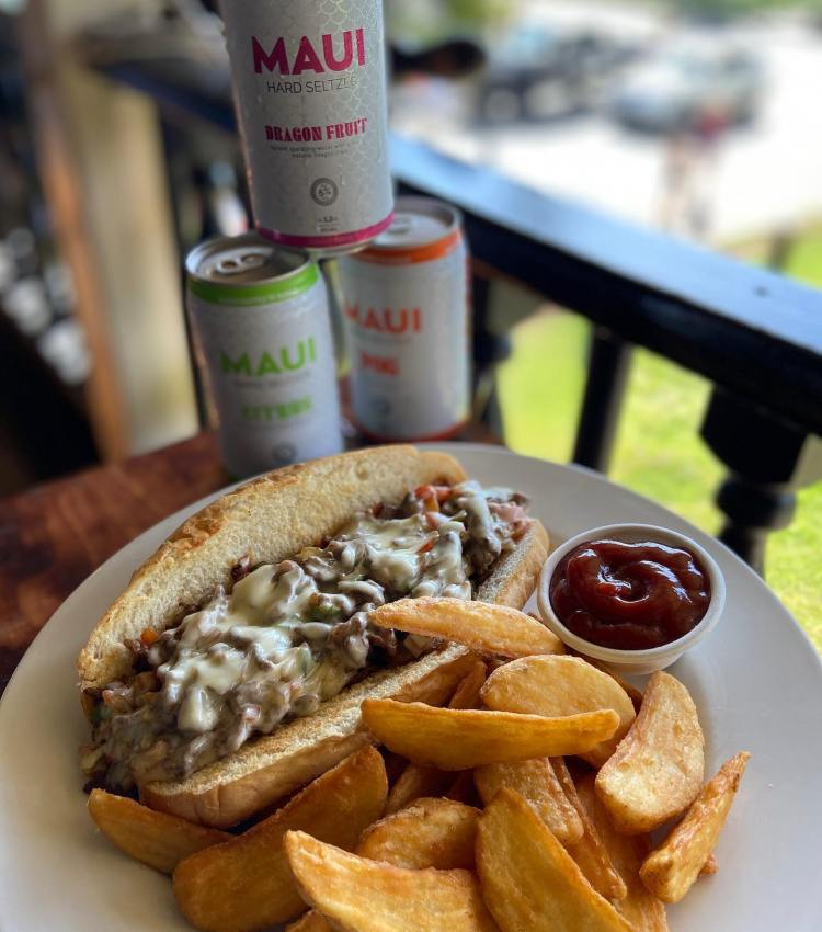 Philly Cheese Steak with Maui Brew Co Seltzer in Lahaina, Hawaii