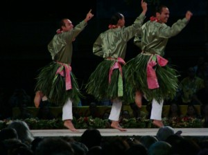 The men of Halau O Ka Hanu Lehua under the direction of Carson Kamaka Kukona III perform an auana hula to Ku'u 'Aina Ho'oheno in Day 3 of the Merrie Monarch Hula Festival in Hilo, Hawaii.