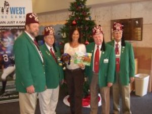 Holiday gifting of Inky Winky Spider books and toys at Shriners Hospital for Children in Tampa, FL.