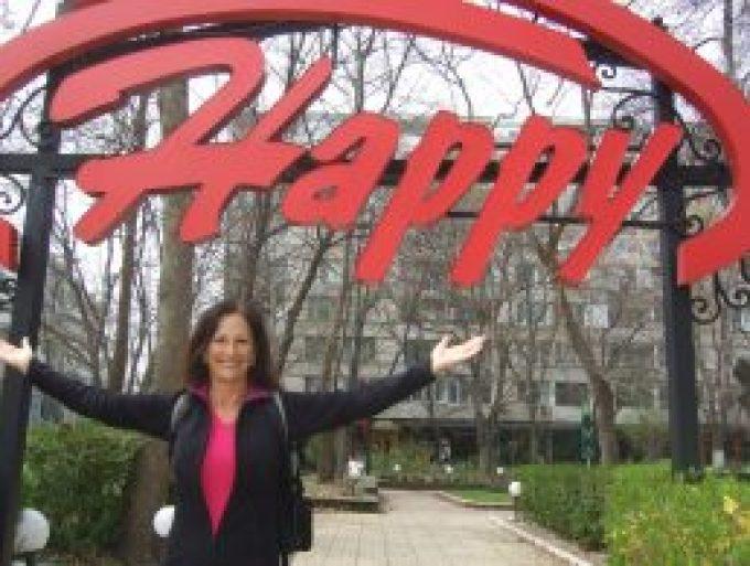 Maura Sweeney World Happiness Survey - taken under the Happy sign.