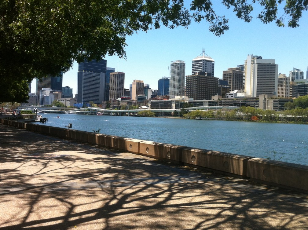 Tall buildings in background with Brisbane River in the middle of the picture