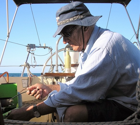 John cooking newly-caught herring for my lunch in an early scene from Elopement: a Memoir