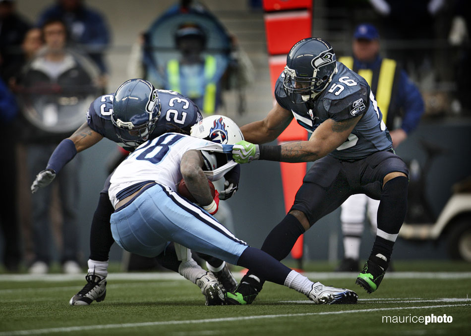 Chris Johnson is tackled by Seahawk defenders.