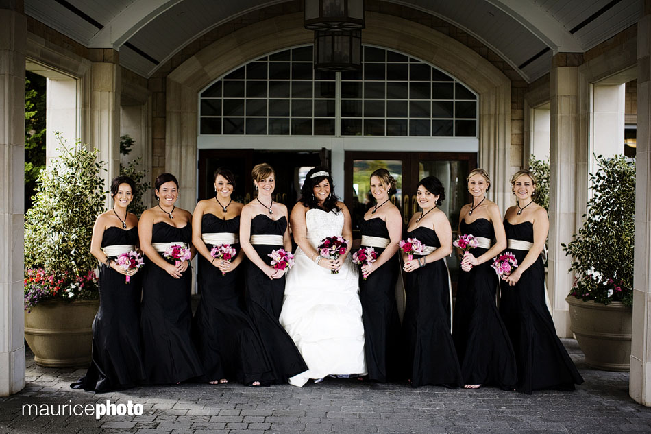 A picture of a bride and bridesmaids posing at Newcastle.