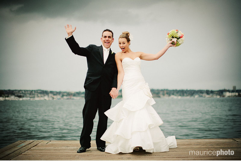 A bride and groom pose for wedding pictures on Lake Union at the Center for Wooden Boats in Seattle.
