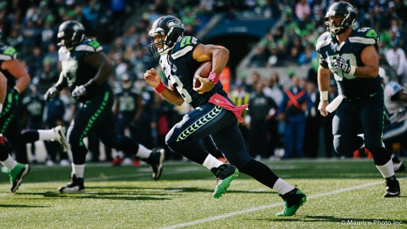 Russell Wilson scrambles against the Titans
