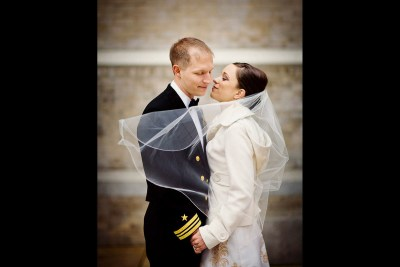 Bride and groom in military uniform