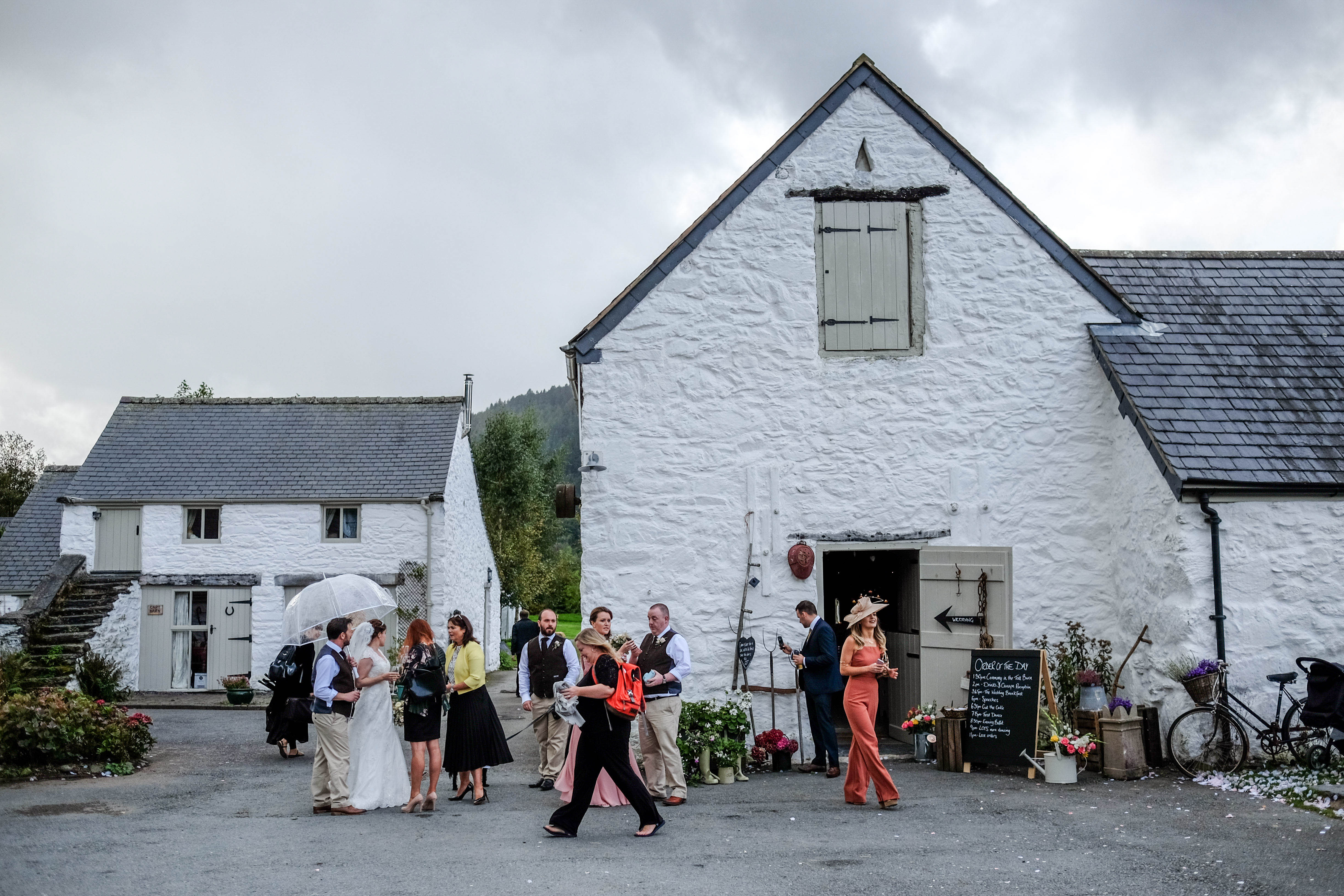 View of the front of Hafod Farm during the drinks reception. Image by North Wales Wedding Photographer Maurice Roberts.