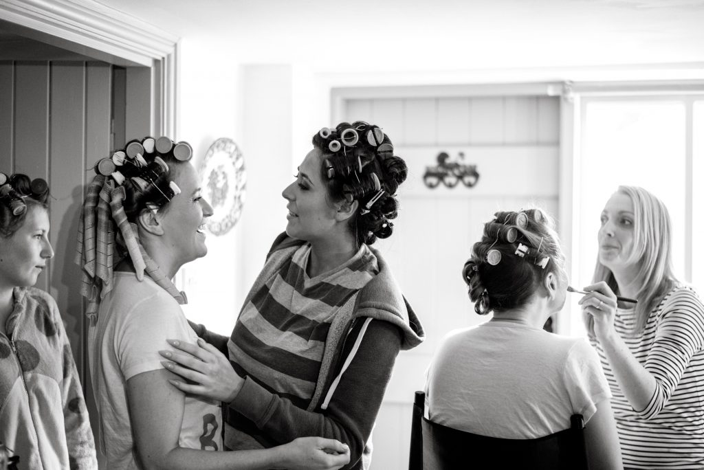 Hafod farm wedding preparations. 4 bridesmaids with rollers in their hair.