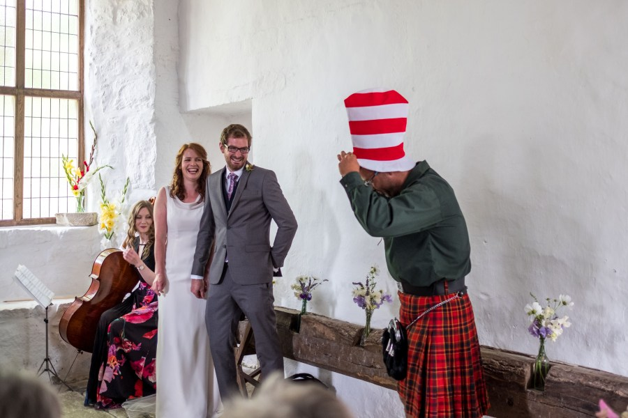 The cat in the hat reading at Penarth Fawr wedding ceremony.