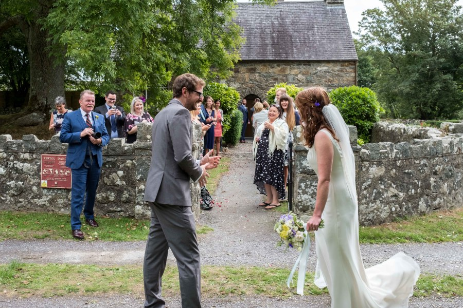 View of the wedding couple with Penarth Fawr in the background