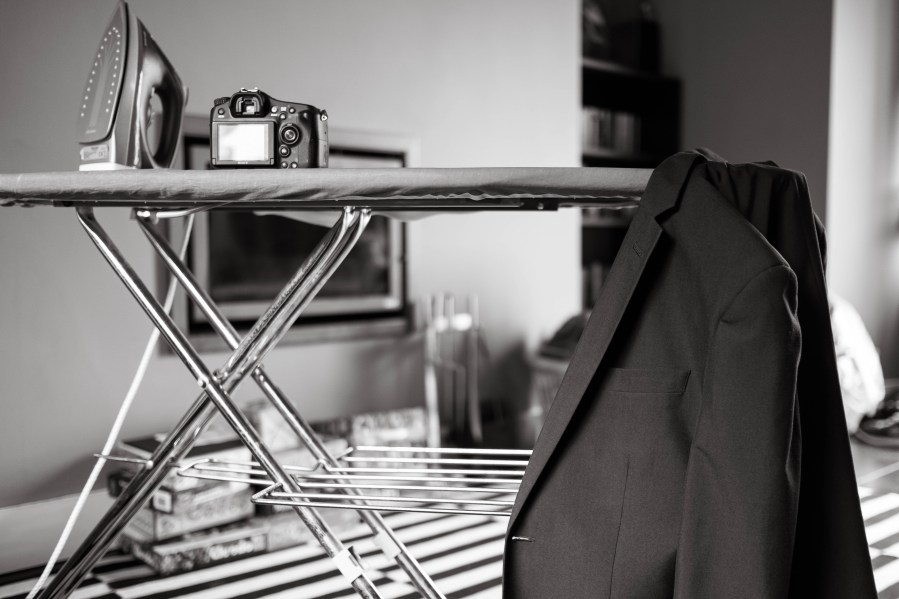 Grooms jacket hanging on an ironing board at Red Welly