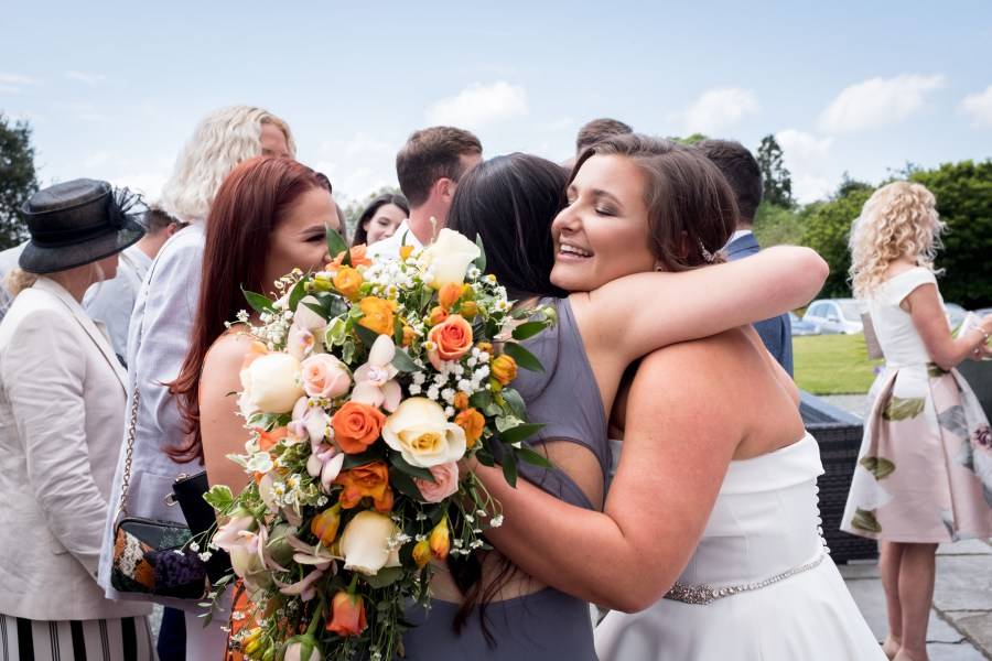 Bride being congratulated by her friend at Bron Eifion