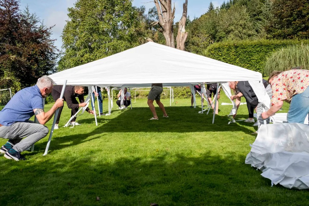 Guests moving the gazebo in the garden at Trevor Hall