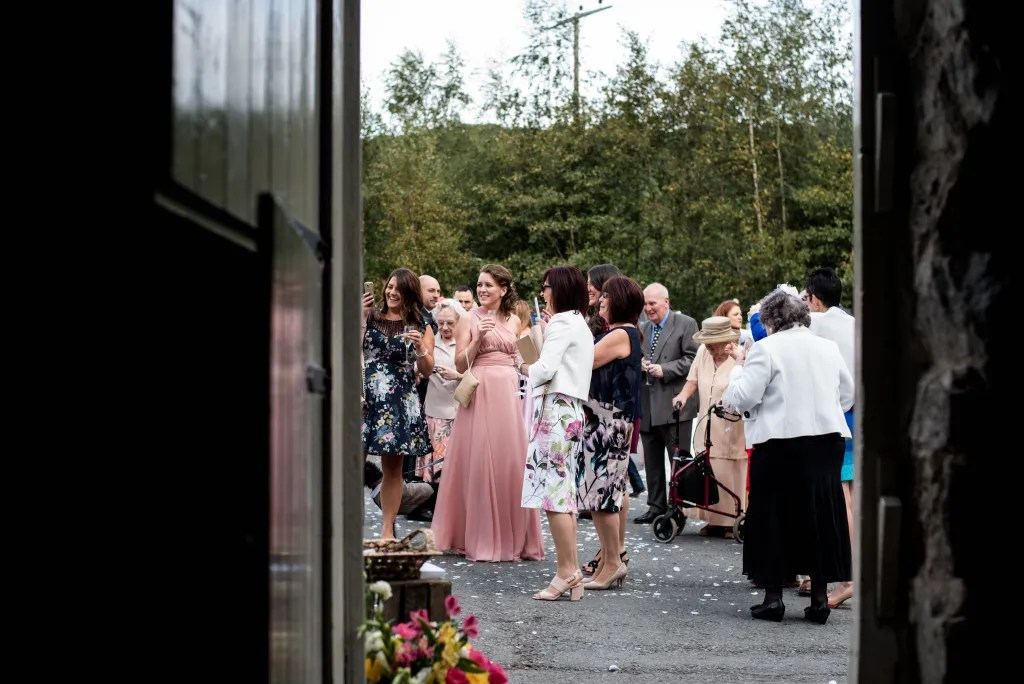 Hafod Farm wedding of Natalie and Vince looking through the venue door towards the guests