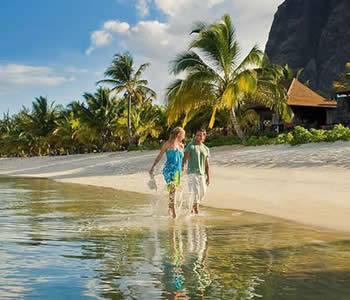 Couple walking on the beach at Le Morne