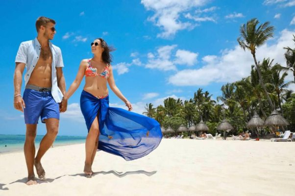 La Pirogue Mauritius Couple Walking on the Beach
