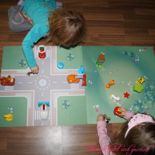 Aufbau Autos und Figuren Playmatt