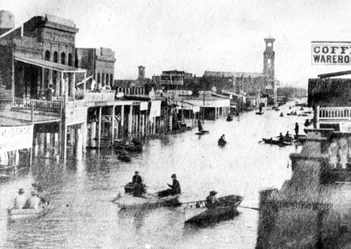 From the USGS: People in Sacramento navigate K Street in rowboats during the California flood of 1861-62, which historians say obliterated up to 25 percent of the assessed property value in the state.