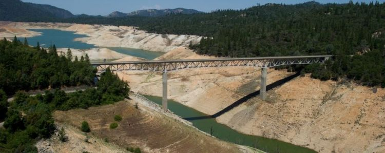 Aerial view at Lake Oroville showing low water level (drought conditions). View is of The Enterprise Bridge (Lumpkin Road) on the South Fork of the Feather River. Shot July 20, 2015 by Paul Hames/DWR Photography. *FOR EDITORIAL USE ONLY *