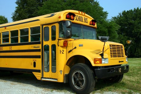 School bus, church and Pioneer Girls