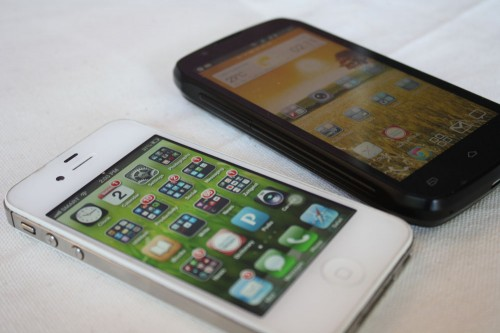The Cloudfone Thrill 430x beside an iPhone 4s. (Photo by Marlen Limpag)