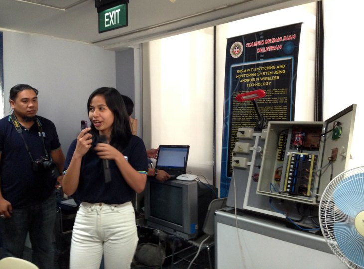 Colegio De San Juan Letran 5th year computer engineering student Frances Marie Kagahastian demonstrates the SMS.AWT: Switching and Monitoring System Using Android in Wireless Technology, a system that allows people to control and monitor lights and appliances in their homes from anywhere. (Photo by Max Limpag)