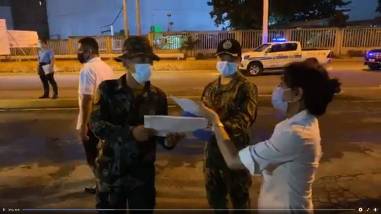 CHECKING ENFORCEMENT. Cebu Gov. Gwendolyn Garcia shows soldiers manning a checkpoint the new IDs of people allowed to cross the border. The Capitol under Garcia makes effective use of Facebook Live.