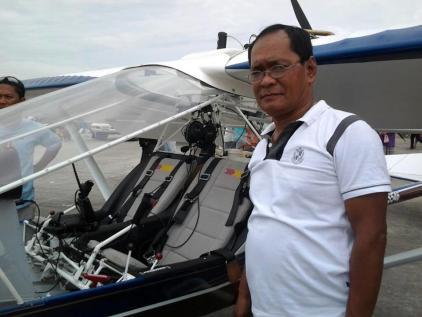 ME beside a light sports plane