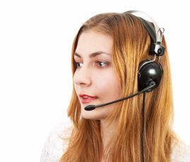 cute techsupport girl talking on the phone using headset