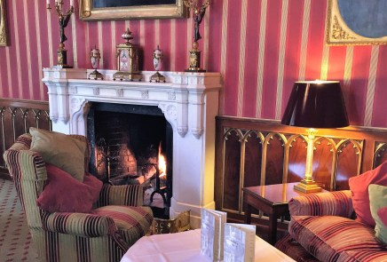 Have a cozy tea by the fire at Dromoland in Ireland.