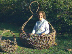 Ruth Duncan sits in one of her kudzu baskets