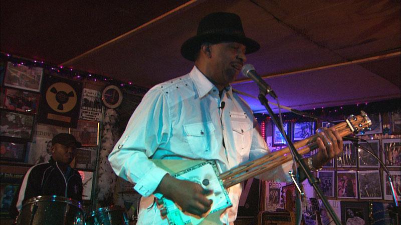 Earl Williams plays a cigar box guitar