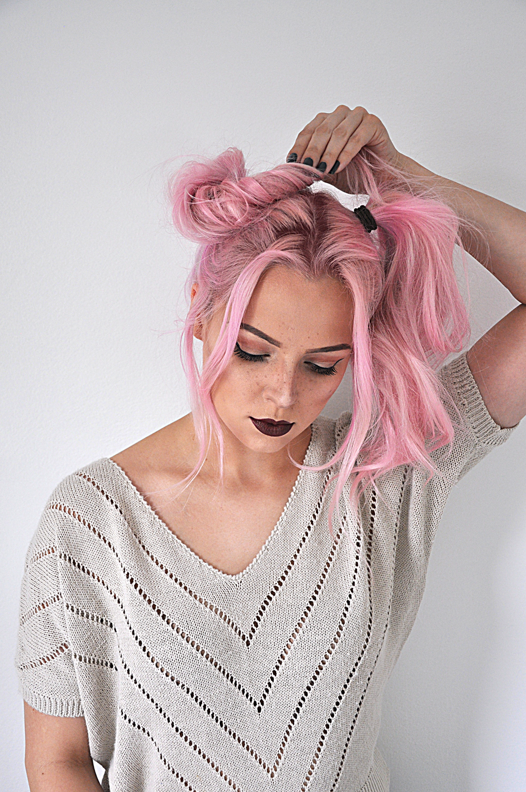 Say goodbye to boring hair and hello to fun with this space buns hairstyle tutorial. Recreate this look at home. It's super easy and only takes 5 minutes!