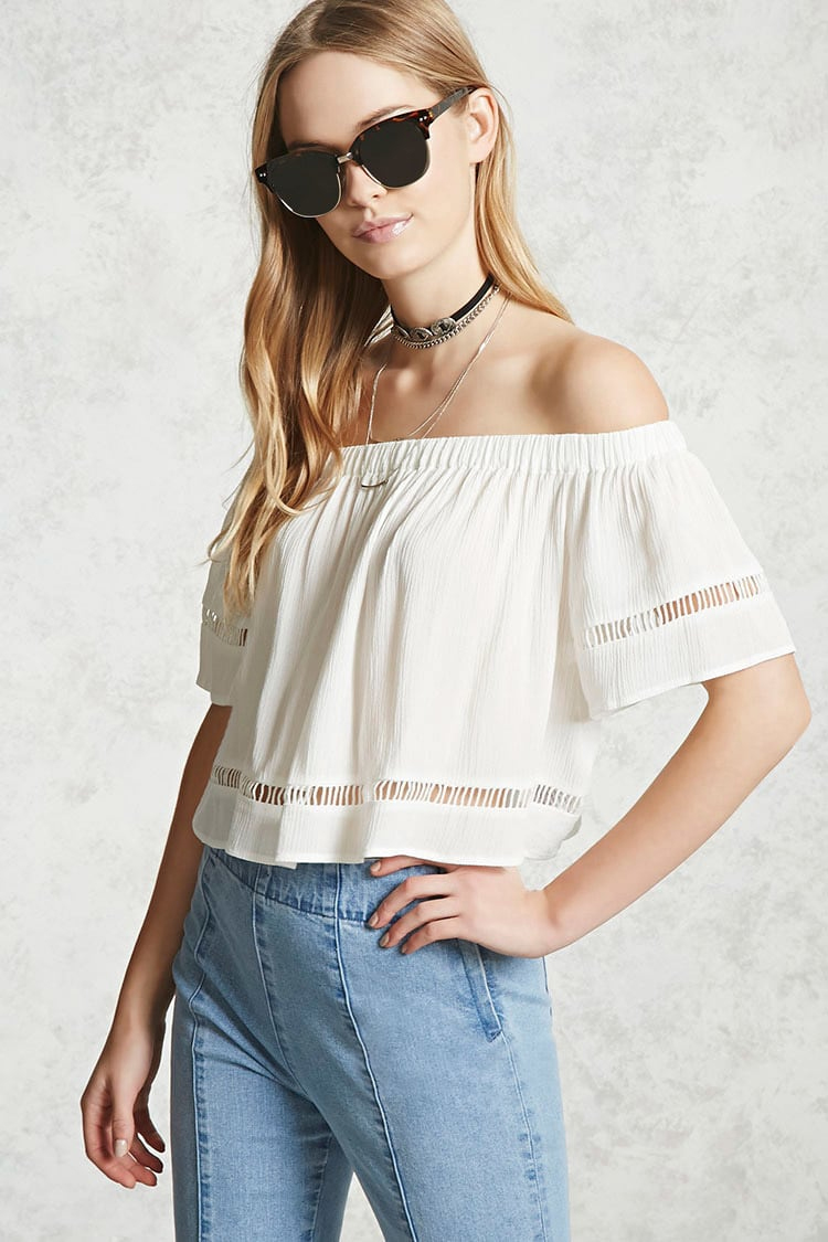A cute off the shoulder crop top with ripped denim and sandals makes for the perfect casual style for a day in the city. I'm in love with this outfit!