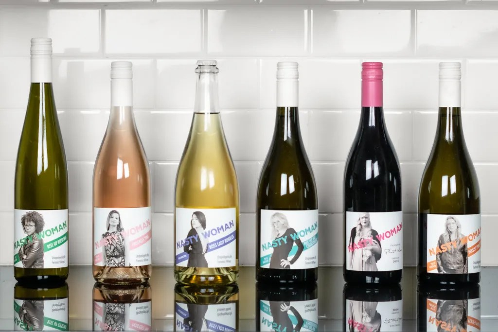 Collection of Nasty Woman Wines sitting on kitchen counter. Staged product photography