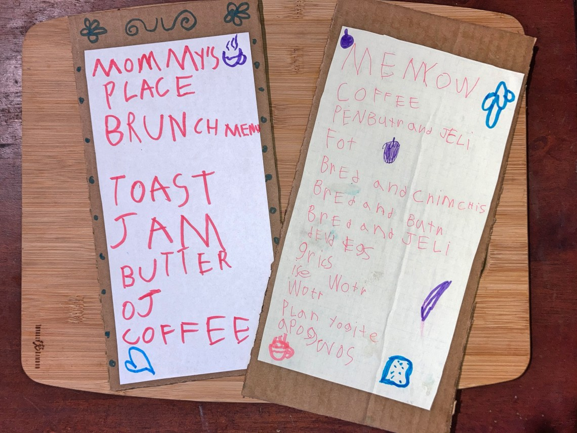 two Mother's Day brunch menus written in a child's handwriting