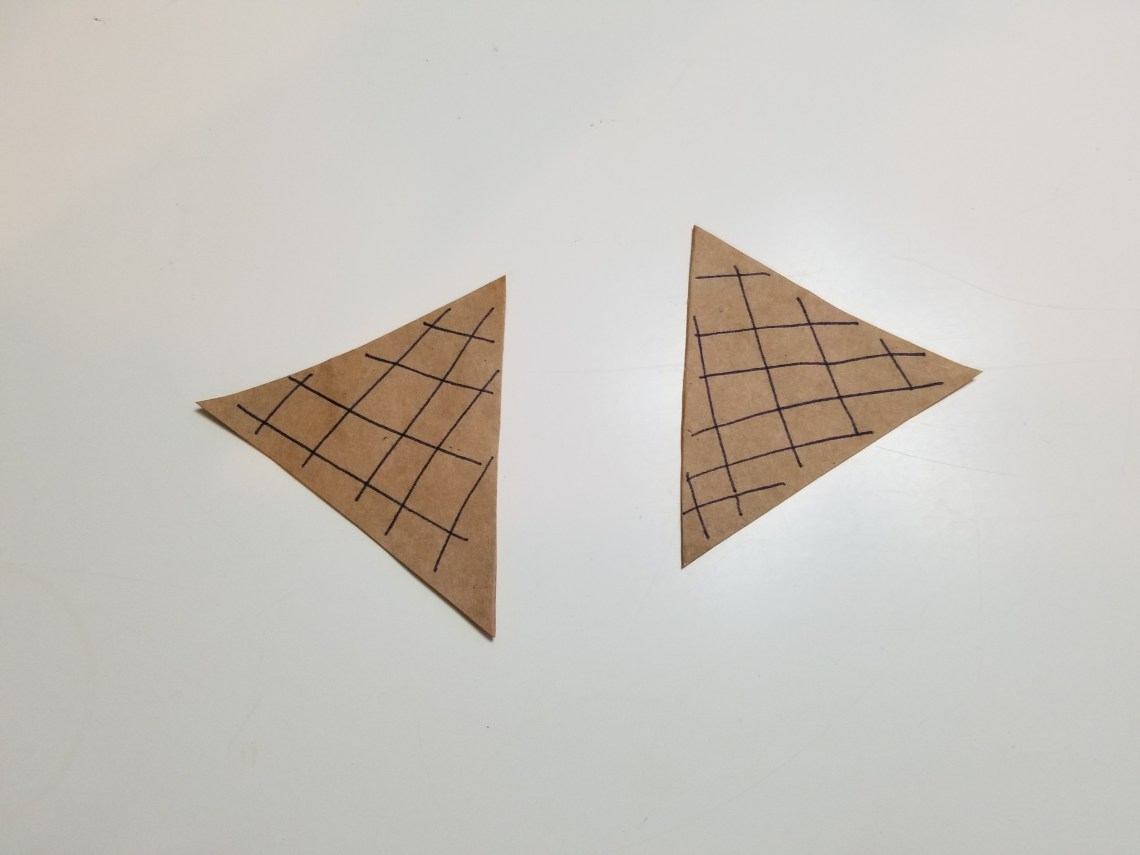 Two ice cream cones made out of a paper bag