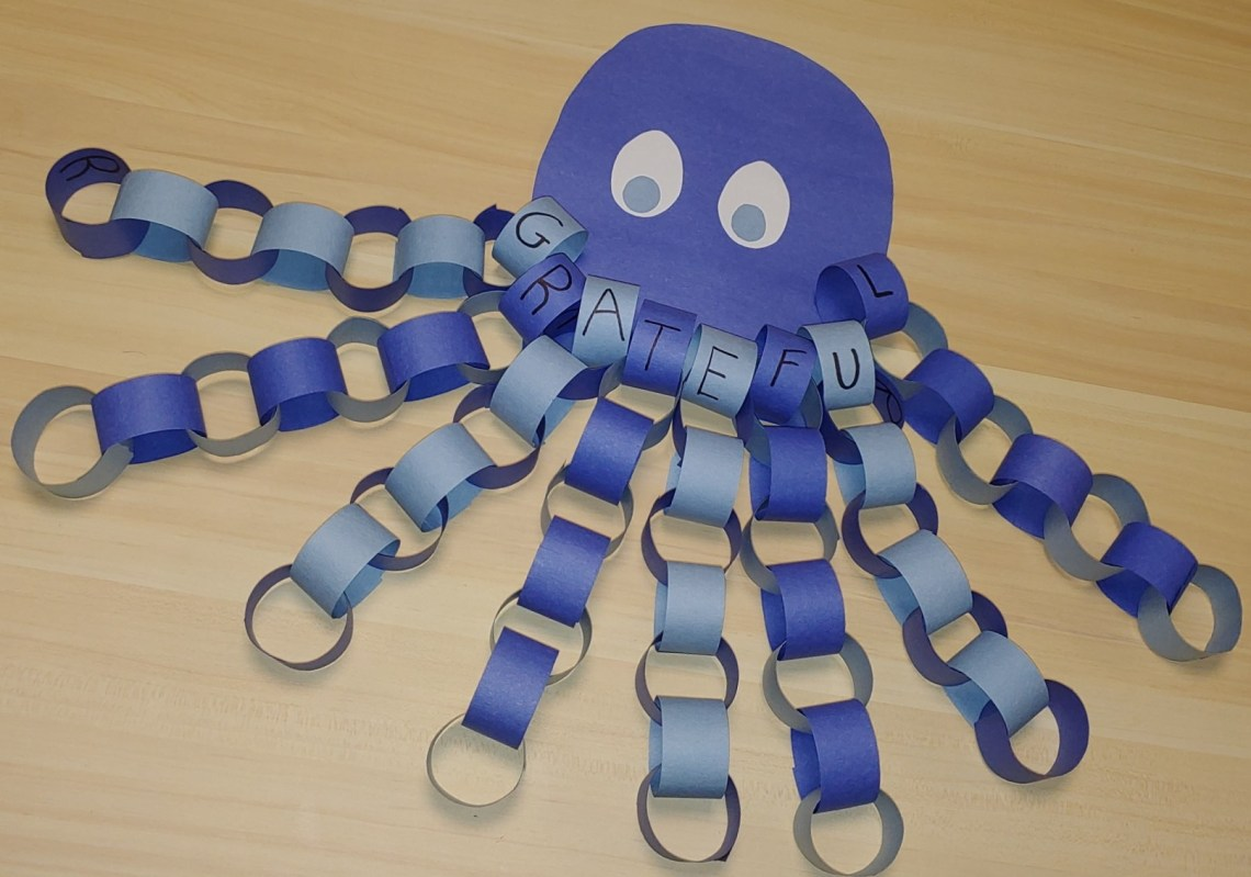 Purple octopus made from construction paper rings