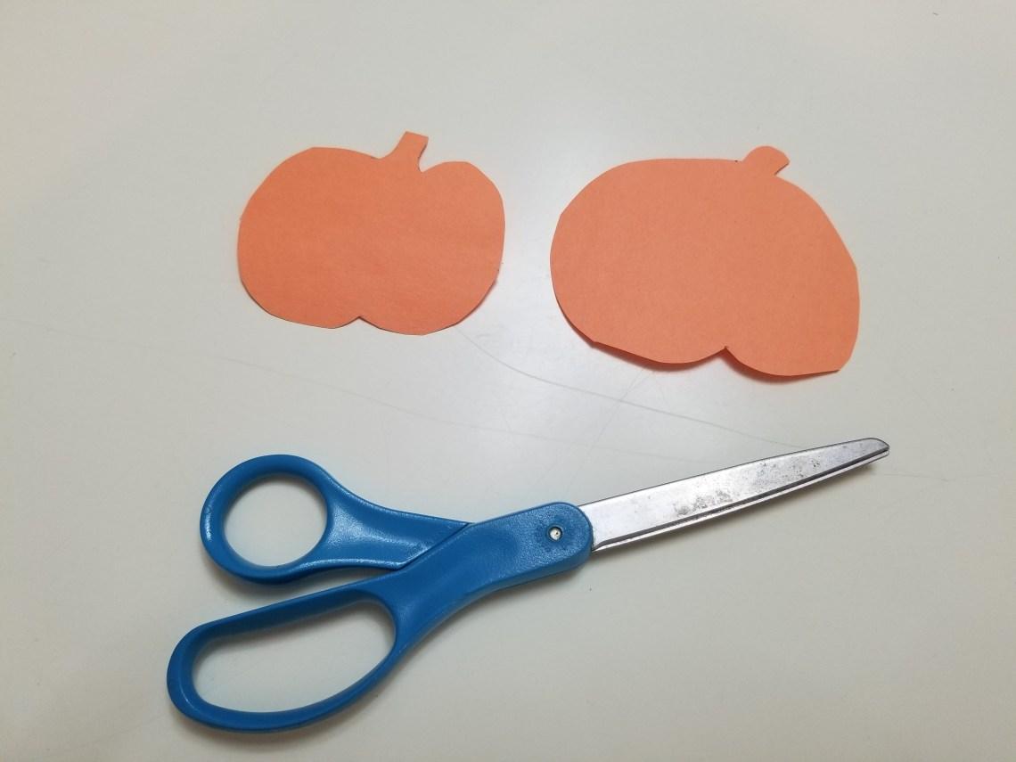 Two orange pumpkins cut out of paper