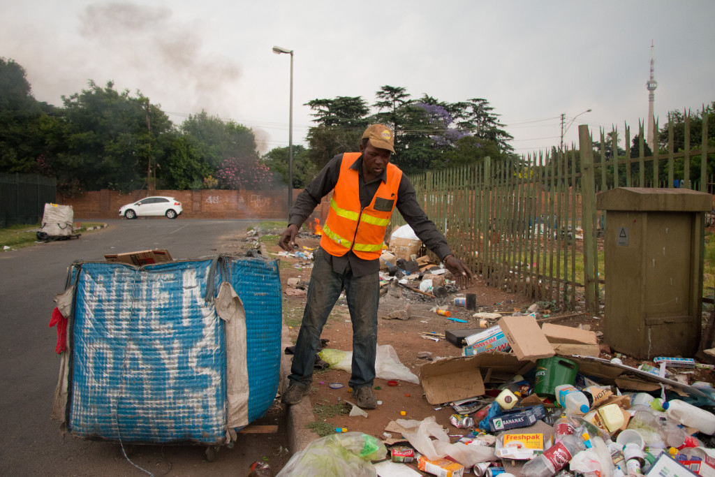 Joseph sorts through what he has collected. He is getting ready to go to the recycling depot. Photo: Samantha Camara