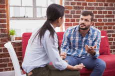 Young woman being mentored by a man