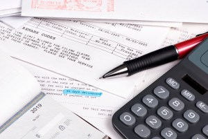 Image of paperwork pen and calculator on desk