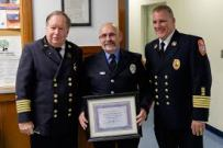 Firefighter Gerry Byrne (center) retiring after 39 years of service.