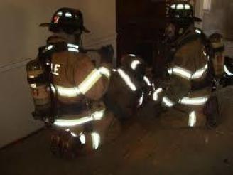 Maynard firefighters training on Rapid Intervention Team (RIT) skills in March 2015.