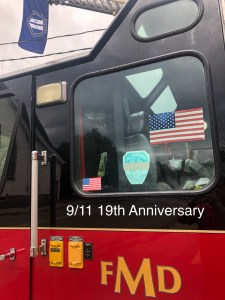 9/11 Flag and faded FDNY Memorial