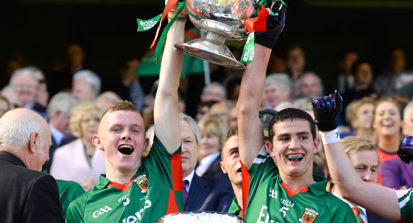 Darragh Doherty (left) lifts the Tom Markham Cup with his teammate, Tommy Conroy on 22nd September 2013